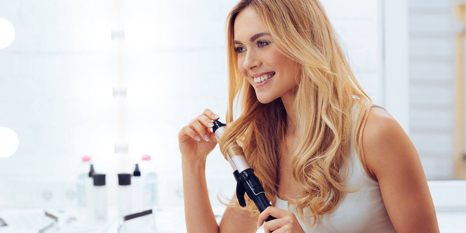 how to properly curl your hair with a curling iron